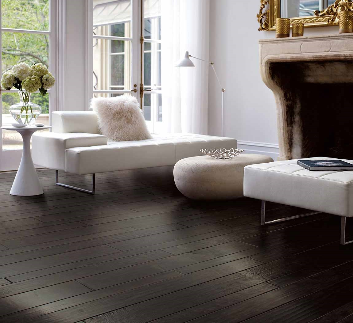 dark hardwood floor in modern living room with white couch