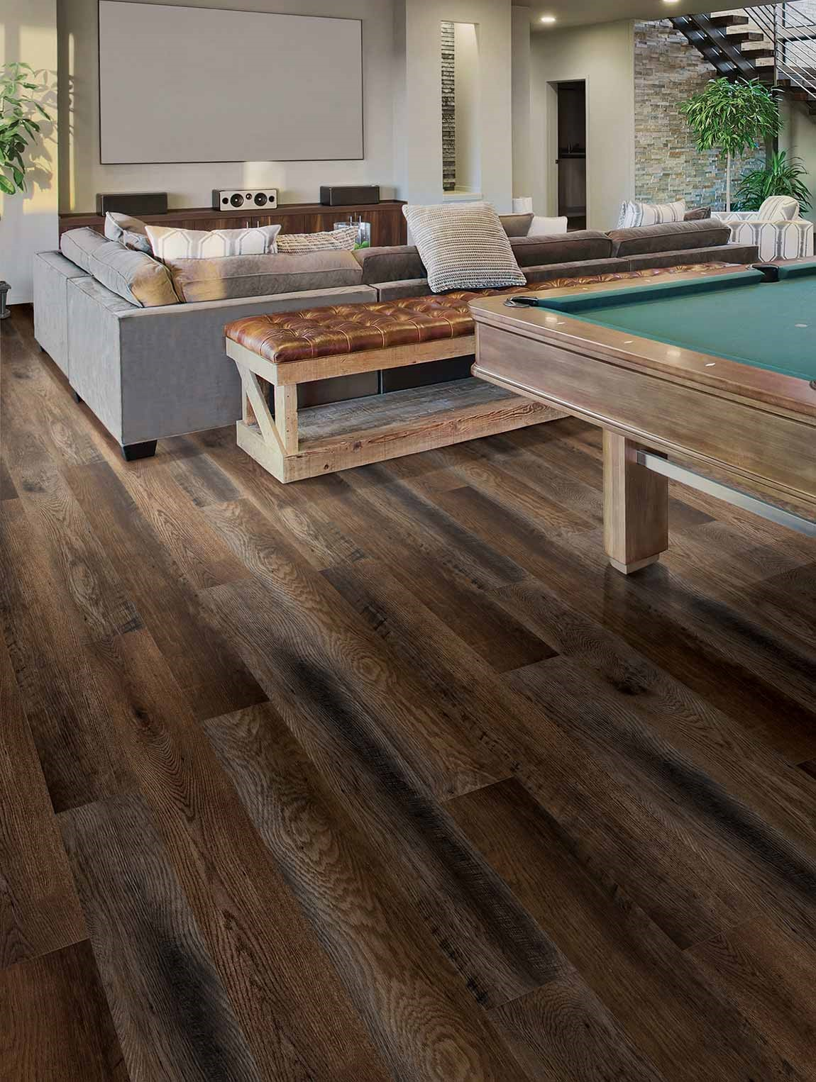 living room with couch and pool table vinyl wood look flooring