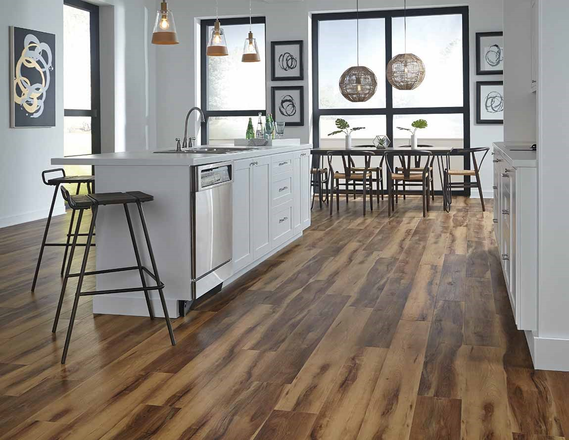 open kitchen with wood look tile flooring